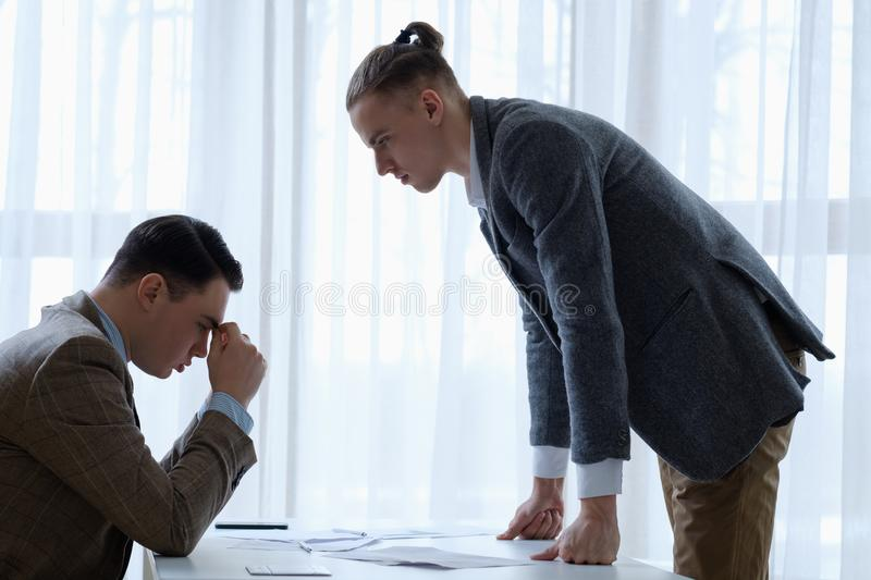 Serious boss dissatisfied employee strict business stock images