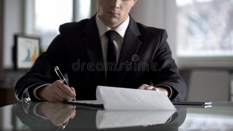 Serious boss signing agreement, important contract for company restructuring. Stock photo royalty free stock images