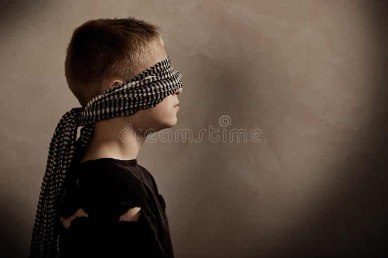 Serious boy blindfolded with copy space in front stock photo