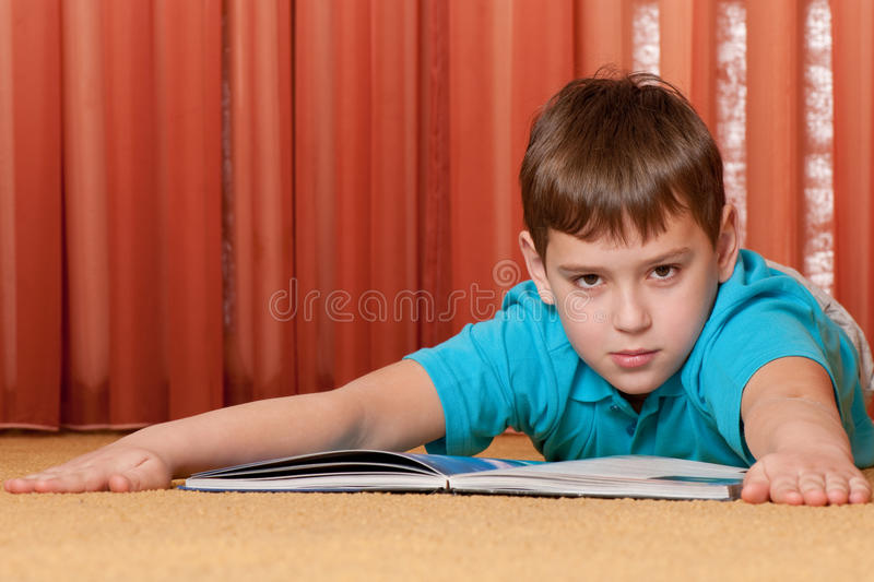 Download Serious boy with a book stock photo. Image of book, home - 19264180
