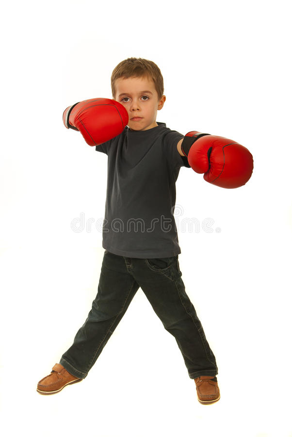 Serious boy with boxing gloves royalty free stock photo