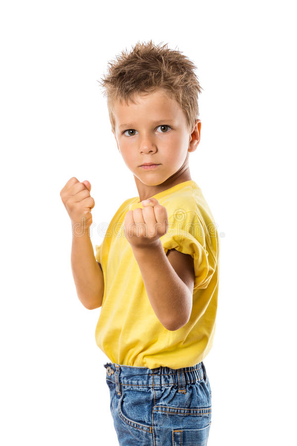 Serious boy showing his fist stock photo