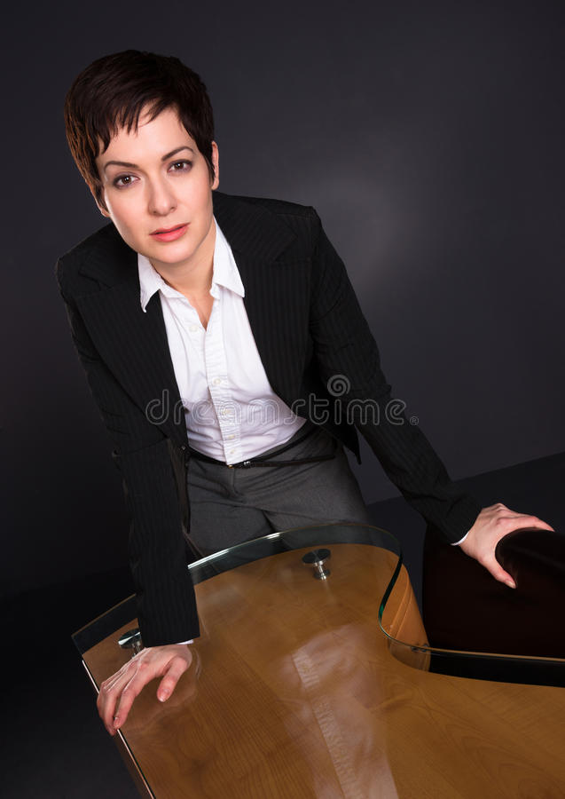 Serious Brunette Woman Draws Attention Business Female Office Po royalty free stock photos
