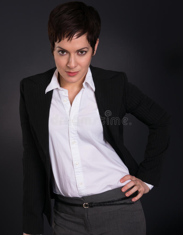 Serious Brunette Woman Draws Attention Business Female Office royalty free stock images