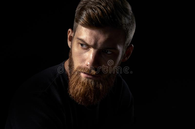 Serious brutal bearded man stock image
