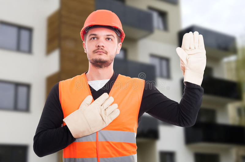 Serious builder taking a vow or oath. As honor and pride concept outdoors stock photos