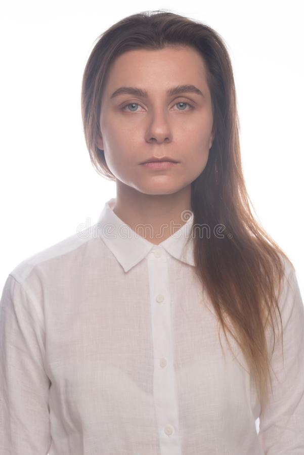 Serious business girl with long hair. Studio portrait royalty free stock photos