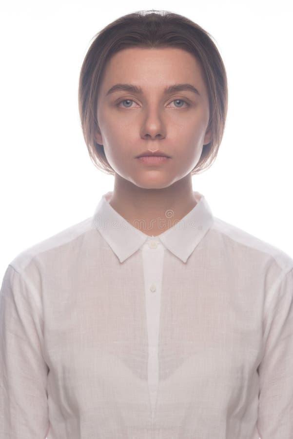 Serious business girl in white shirt. Studio portrait stock photos