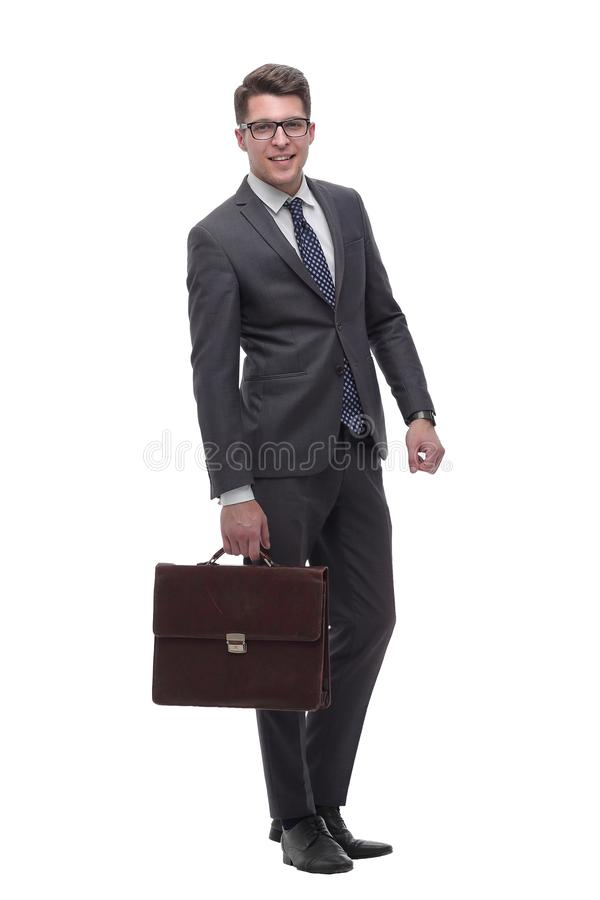 Serious business man with a leather briefcase. isolated on white royalty free stock image