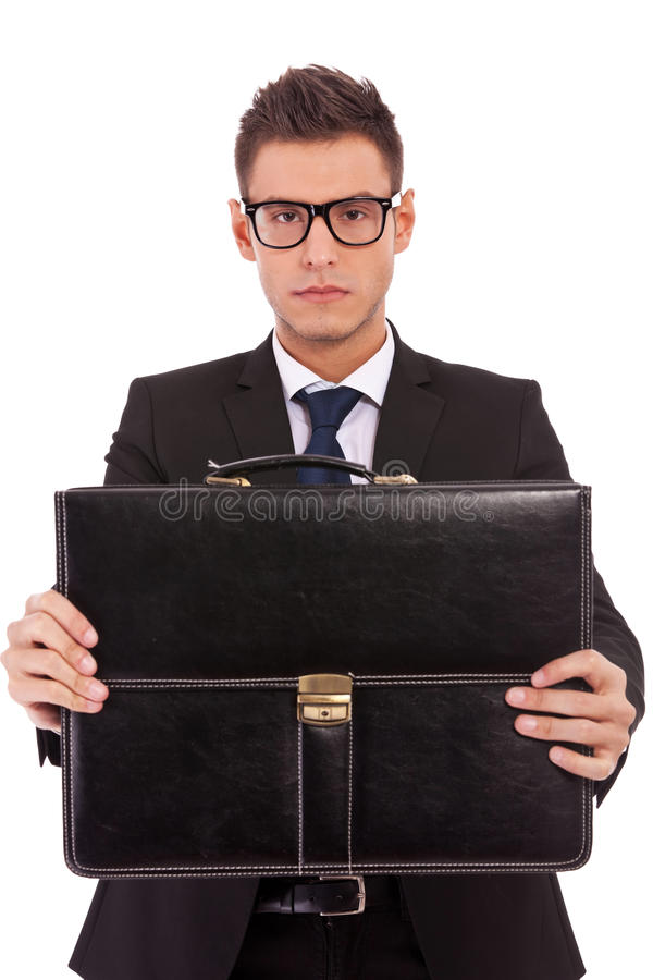 Download Serious Business Man Offering A Briefcase Stock Image - Image: 24441091