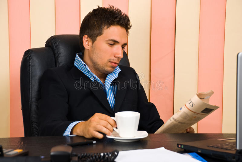 Download Serious Business Man Reading Newspaper Royalty Free Stock Photography - Image: 14776697
