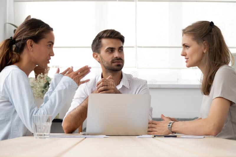 Serious business partners discussing project or business strategy at negotiations royalty free stock photos