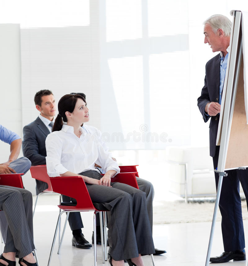 Serious business people at a conference. In the office stock photos