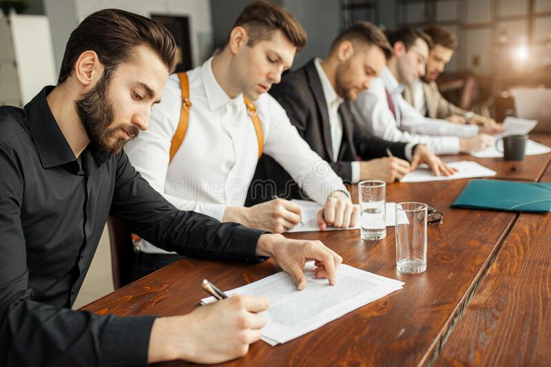 Serious business people hold meeting in office royalty free stock photos