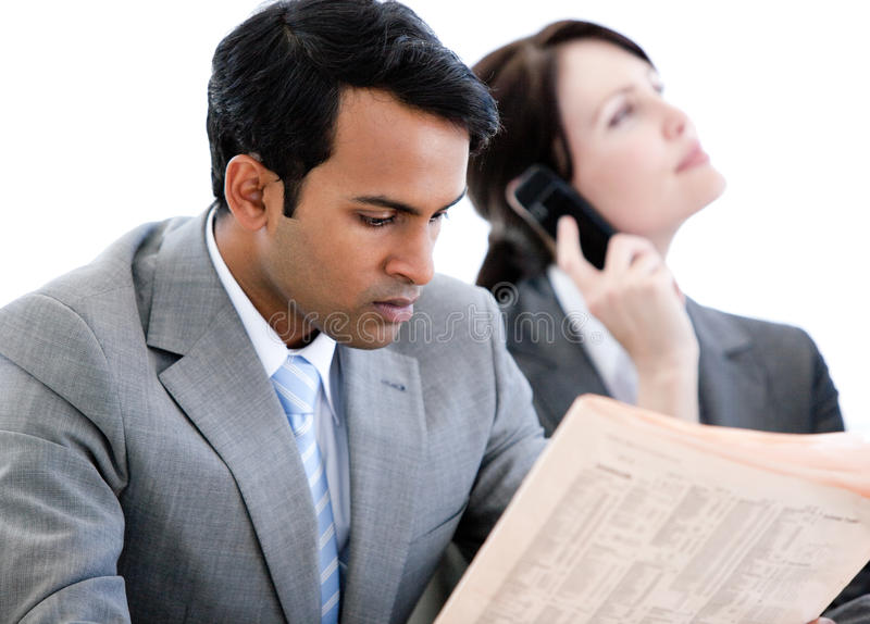 Serious business people relaxing royalty free stock image