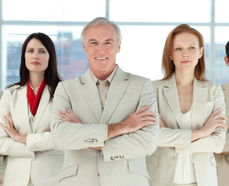 Download Serious Business Team With Folded Arms Royalty Free Stock Photo - Image: 12119065