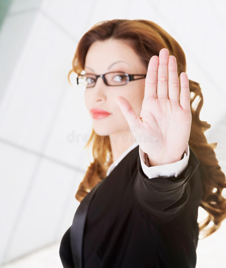 Serious Business Woman Gesturing Stop Royalty Free Stock Photography