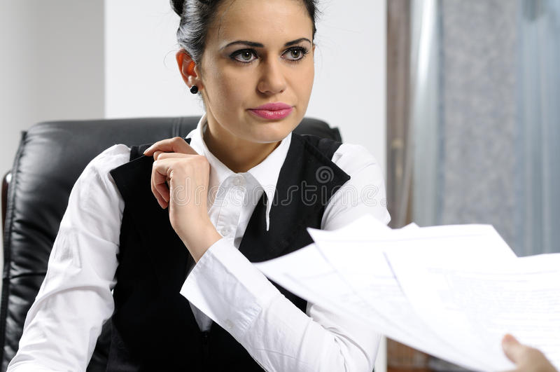 Serious business woman interviewing royalty free stock photography