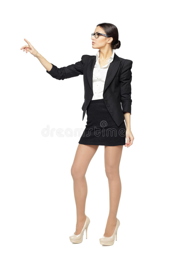 Serious business woman pointing at copy space royalty free stock image