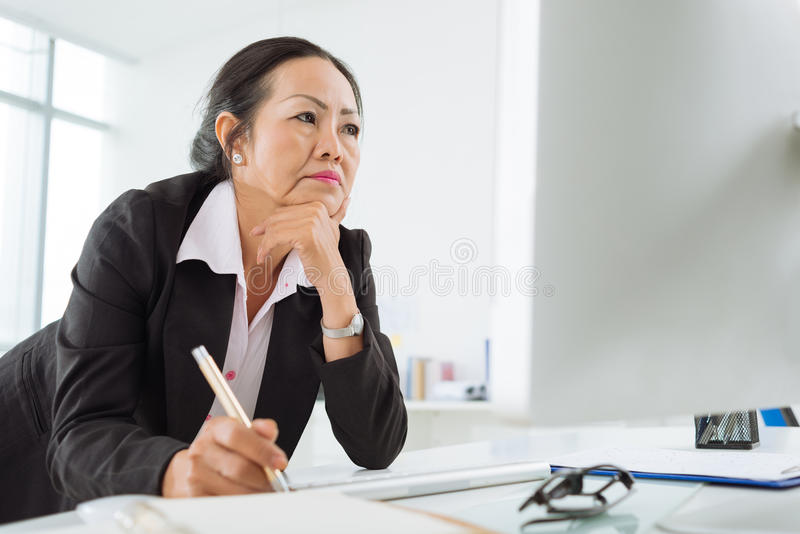 Serious business woman stock photo
