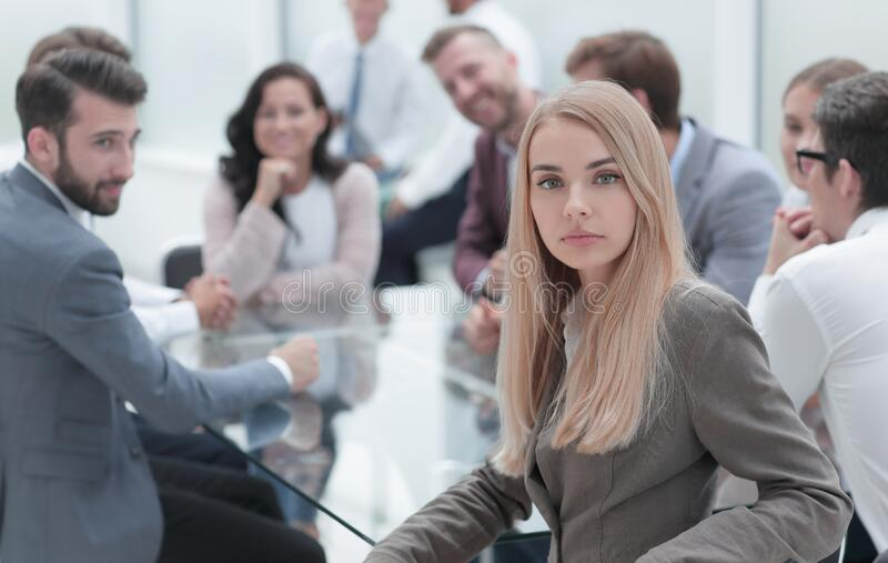 Serious business woman sitting at a table in a conference room. Serious business women sitting at a table in a conference room . business concept stock images