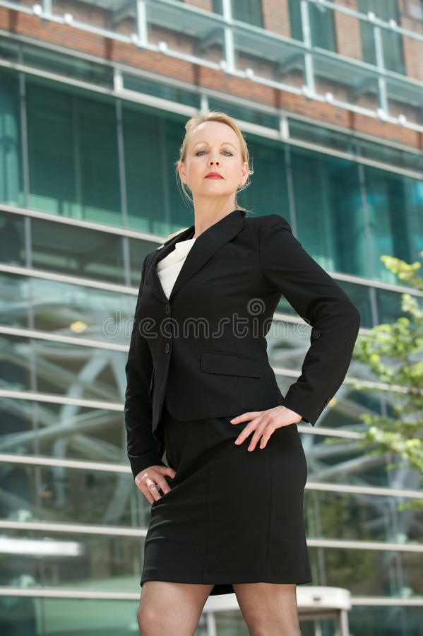 Serious Business Woman Standing Outside The Office Stock Photography