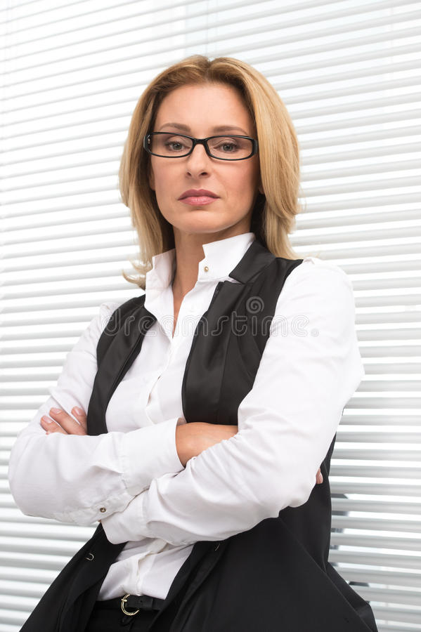 Serious business woman in white shirt. royalty free stock photography