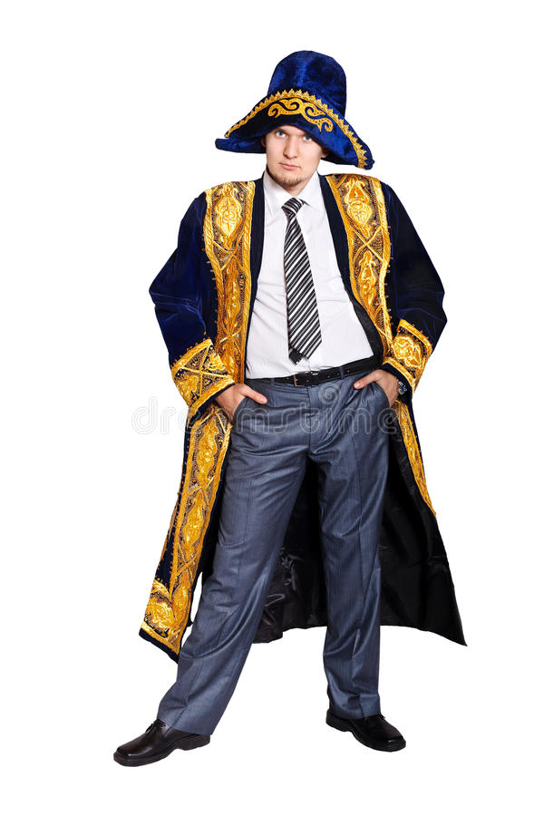 Serious Businessman in Asian national costume. With arms in the pockets isolated on white background royalty free stock image