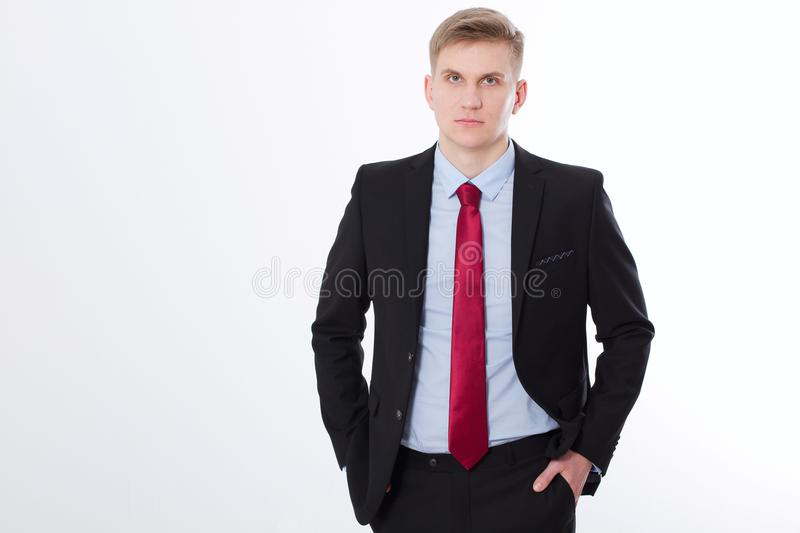 Serious businessman in black suit and red tie isolated on white background. Business concept. Copy space and mock up stock image