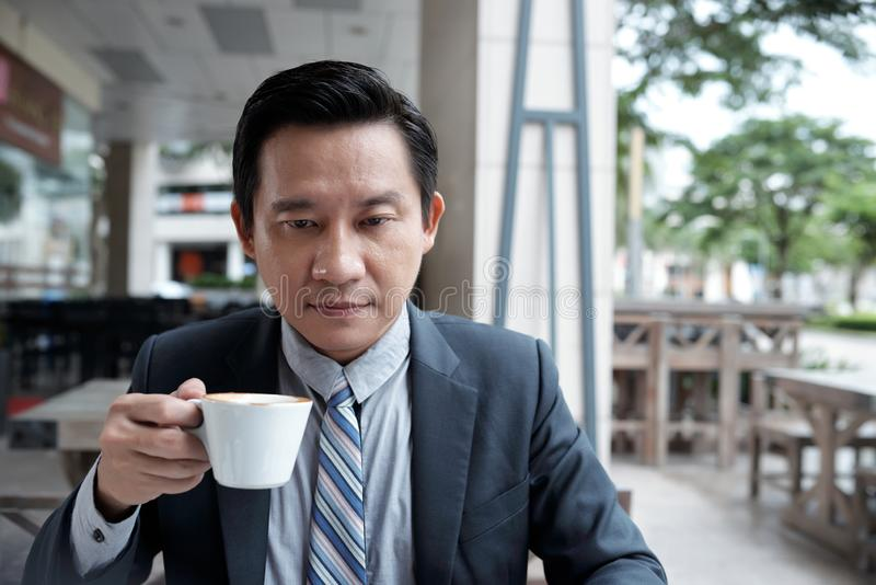 Serious businessman in cafe stock images