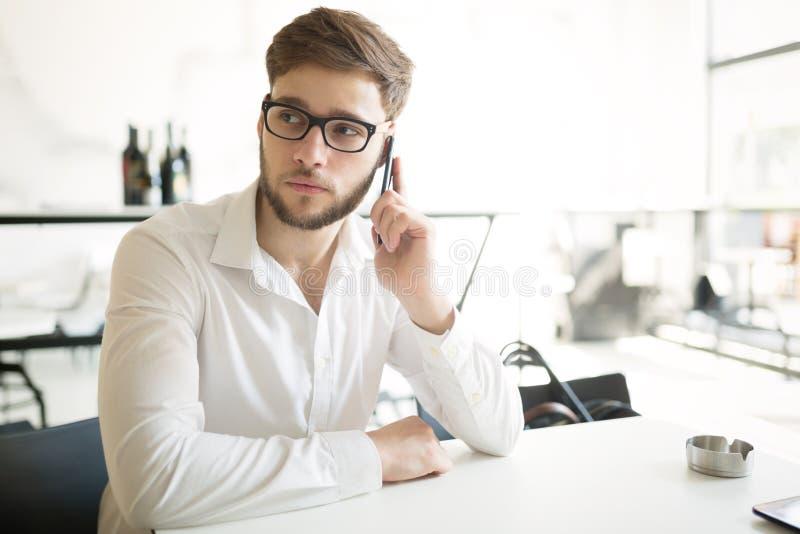 Serious businessman on coffee break royalty free stock image