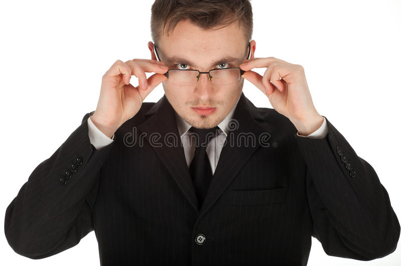Serious businessman correcting glasses stock photos