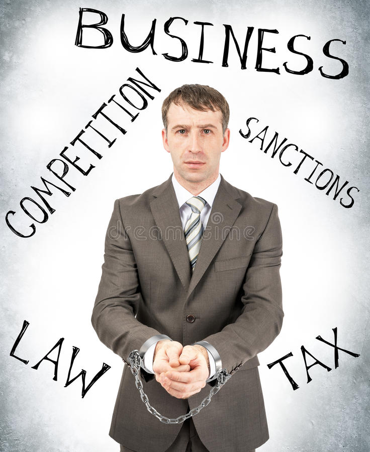 Serious businessman in cuffs stock image