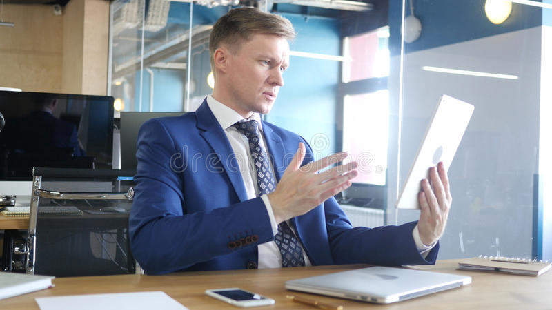 Serious businessman Doing Online Conference on the Tablet, Communication conc stock images