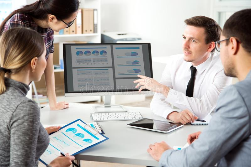 Businessman explains to colleagues a new project. Serious businessman explains to colleagues a new project stock photos
