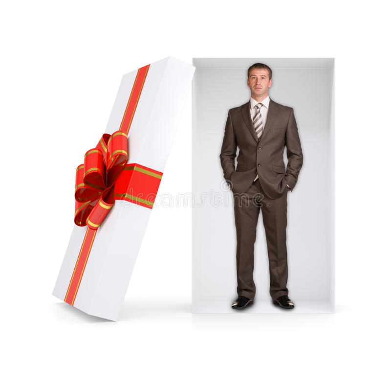 Serious businessman in gift box on white royalty free stock images