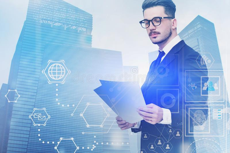 Serious businessman in glasses, digital interface stock photo