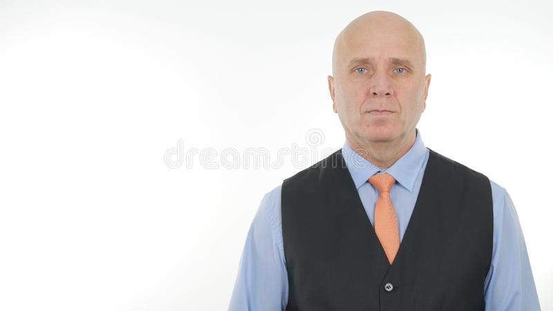 Serious Businessman Image Representing a Corporate Management royalty free stock photography