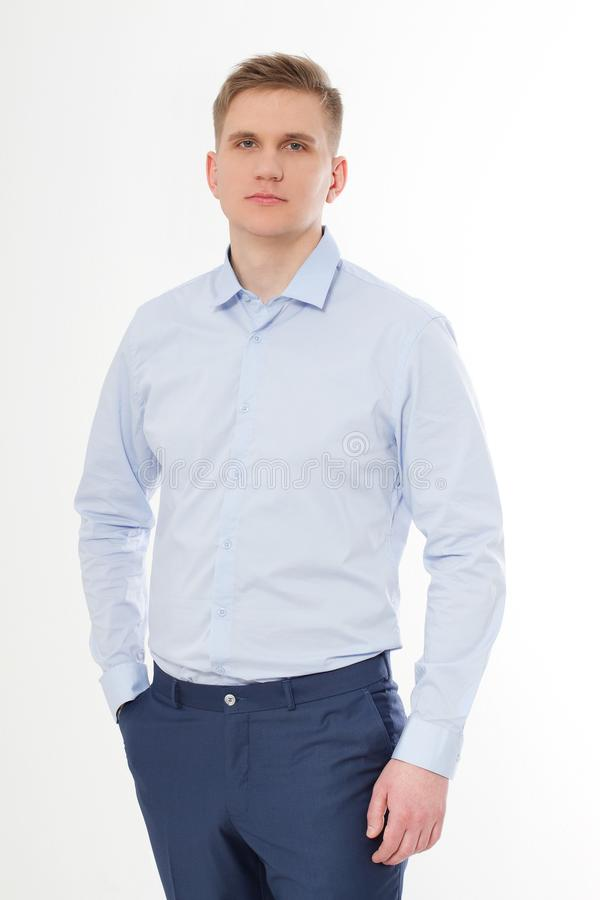 Serious businessman isolated on white background. Blue template and blank Shirt on man. Copy space and mock up stock photos