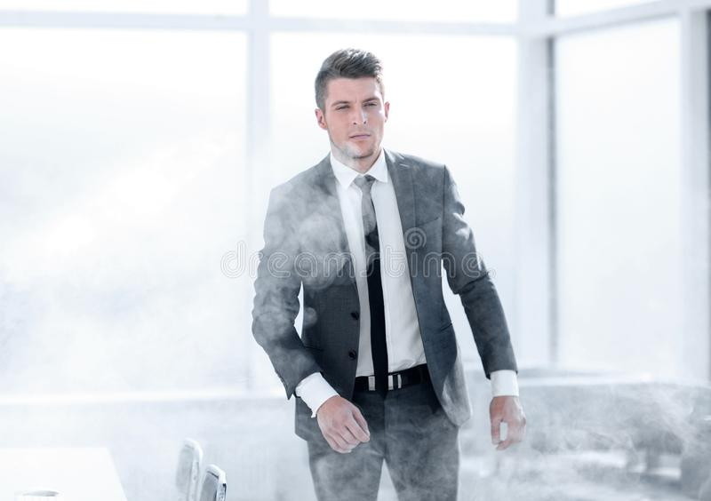 Serious businessman during a fire alarm. Serious businessman leaves the office building during a fire alarm royalty free stock image
