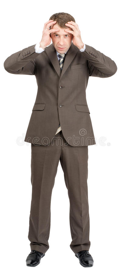 Serious businessman looking at camera stock images