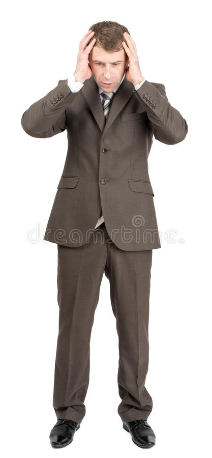 Serious businessman looking down royalty free stock photography