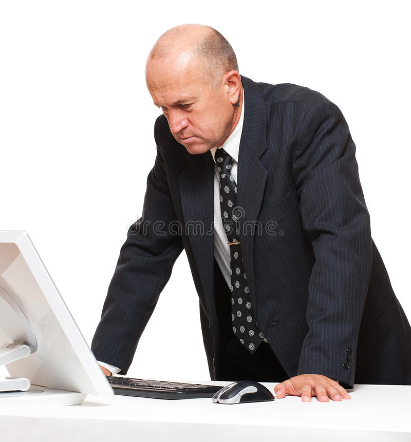 Serious Businessman Looking At Monitor Stock Photography
