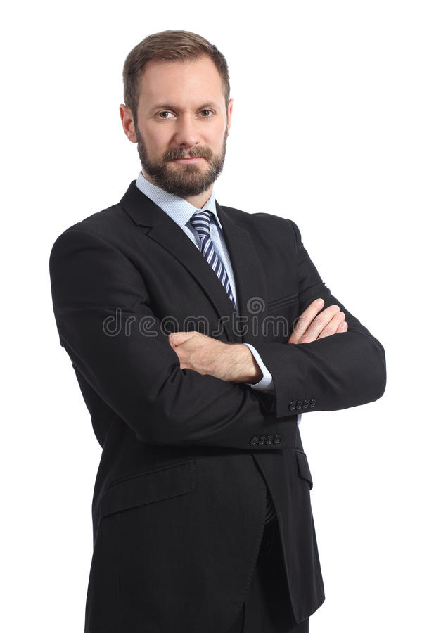 Serious businessman posing with folded arms royalty free stock photography