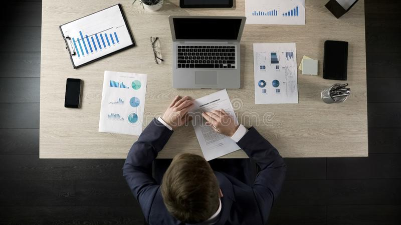 Serious businessman reading and signing purchase agreement, public procurement royalty free stock photography