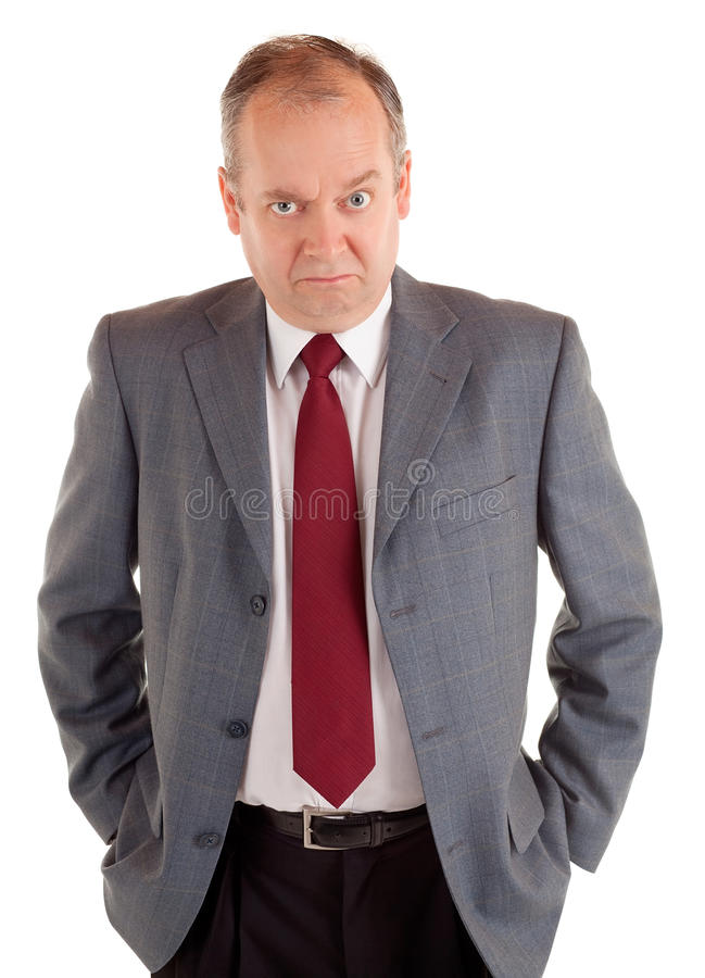 Serious Businessman With A Scowling Expression Royalty Free Stock Photography