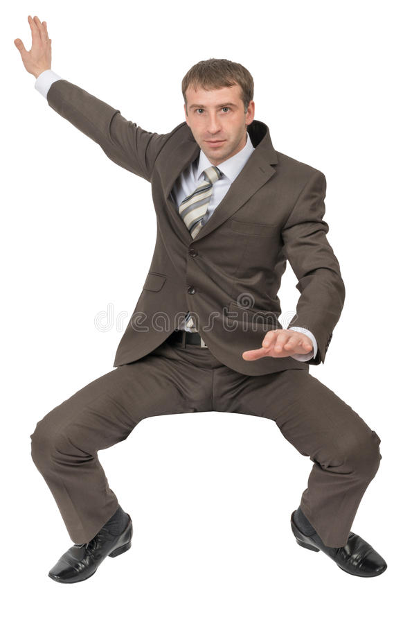 Serious businessman sitting on empty space royalty free stock photo