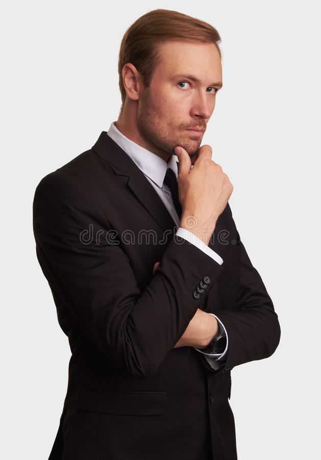 Serious businessman thinking. Isolated stock photography