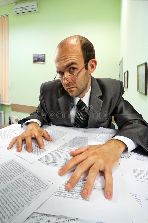 Serious businessman working in office royalty free stock photography