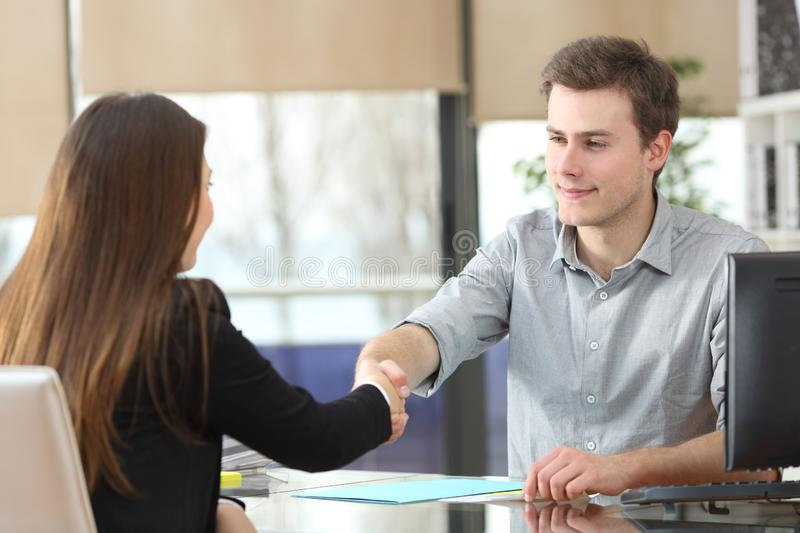 Serious businesspeople handshaking at office royalty free stock photos